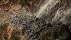A small waterfall in the mountains Stock Footage