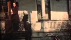 1948  ,  Mom and kids entering home by porch Stock Footage