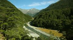 River running through a valley near Broderick Hut, New Zealand Stock Footage