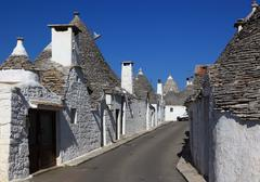 Trulli houses with round stone roofs Alberobello Apulia Italy Europe - stock photo