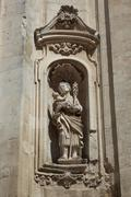 Figure on the portal of the Basilica of San Martino Martina Franca Apulia Italy - stock photo