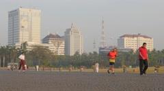 People jogging in Merdeka in early morning,Jakarta,Java,Indonesia Stock Footage