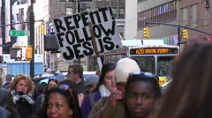 The busy streets of Manhattan, New York include religious people urging - stock footage