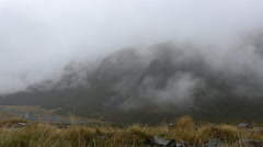 Footage of fog rolling across the mountains in New Zealand Stock Footage