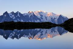 Mont Blanc massif at sunrise reflected in Lac de Chesserys Montblanc on the Stock Photos