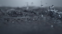 4K 30fps, Heavy rain on water surface, Slow Motion - stock footage