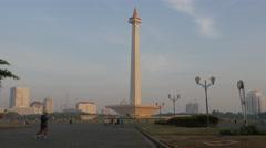 People jogging in Merdeka with Monas tower,Jakarta,Java,Indonesia Stock Footage