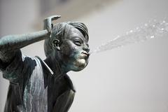 Stock Photo of Fountain statue spewing water out of mouth Schangelbrunnen Altstadt Koblenz