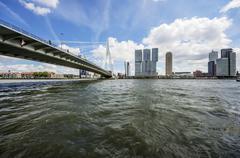 Skyline with Erasmus bridge or Erasmusbrug New Meuse Rotterdam Holland The - stock photo