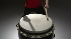Stock Video Footage of anonymous girl playing Taiko performs at the drum, increasing the rhythm, sound