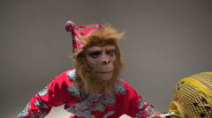 Orange, red monkey symbol 2016, the character in the costume of the Chinese - stock footage