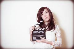 Stock Photo of Young beautiful actress with clapper board