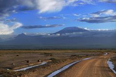 Vast landscape with a road Mount Kilimanjaro in the morning light behind Kuvituskuvat