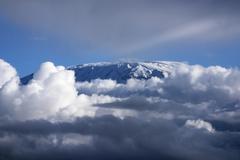 Kibo summit or Uhuru Peak of Mount Kilimanjaro iced over Amboseli Kenya Africa Stock Photos
