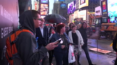 A man stands in Time Square, New York City and reads passages from the Bible. Stock Footage