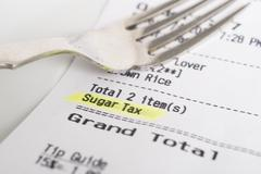 Sugar tax charge Stock Photos