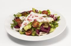 squid with a mixed salad on a white plate - stock photo