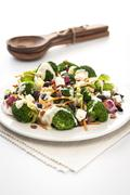 Brocoli and feta salad with dressing - stock photo