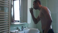 Man washing his teeth Stock Footage