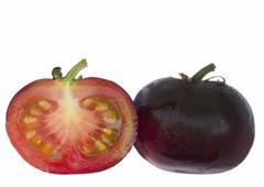 Black Tomato Indigo Rose sliced open and whole Stock Photos