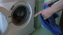 Removing clothes from the washing machine Stock Footage