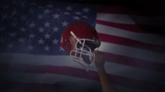 American football player holds his helmet up in air Stock Footage