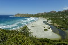 Plage dOstriconi beach by the Ostriconi at LIle Rousse Deserte of Agriates Stock Photos