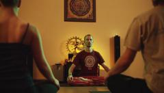 Group meditation with the teacher in a yoga class. Dolly shot Stock Footage