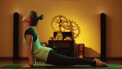 Girl doing yoga exercises in cozy yoga class - stock footage