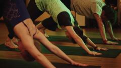 Stock Video Footage of Group yoga Class in a cozy room with candles. Soft and warm subdued lighting