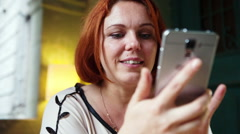 Woman hands texting, sending sms on smartphone at cafe and showing emotions Stock Footage