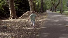 Little Boy Gets Running Start, Climbs Up Huge Pile Of Mulch Stock Footage