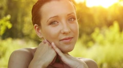 Young woman with bared shoulders Stock Footage