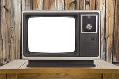 Old Television with Cut Out Screen and Rustic Wood Wall - stock photo