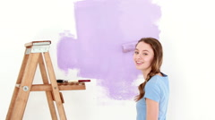 Pretty girl redecorating her house Stock Footage