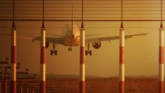 The plane is landing at sunset on the runway of the airport Domodedovo, Moscow R Stock Footage