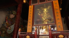 Heavenly Kings and Maitreya inside the temple of Yingjiang Temple, China. Stock Footage
