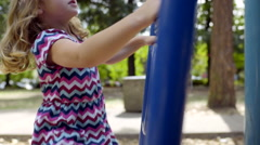 Little Girl Climbs On Play Structure In Playground On Sunny Day (Slow Motion) Stock Footage