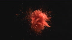 Red powder/particles fly after being exploded.  4K 30fps. Slow Motion. Stock Footage