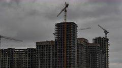 Construction of a multistory building, flying cloud Stock Footage