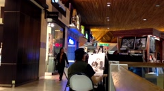 Man artist painting picture inside Coquitlam shopping mall Stock Footage