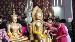 People pasted gold on Buddha, the most important Buddhist ritual Stock Footage