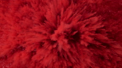 Red powder/particles fly after being exploded.  4K 30fps. Slow Motion. - stock footage