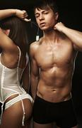 Muscular sexy man and sexy woman back Stock Photos