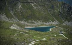 Reservoir in the shape of a heart Goldried High Tauern National Park Matrei - stock photo
