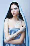 beautiful young woman with bright glamour make-up in frozen art body-art - stock photo