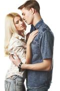 Sexy young couple wearing jeans in the studio Stock Photos