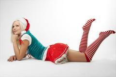 Young sexy Santa Girl isolated on white background - stock photo