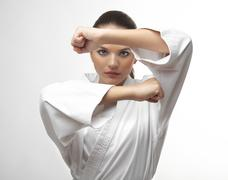 Attractive young sexy women in a karate pose - stock photo