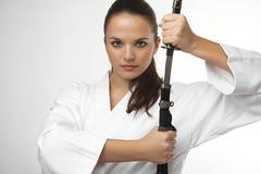 Attractive young sexy women with samurai sword - stock photo